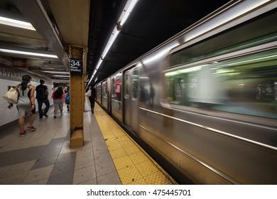 Subway train arriving at platform in Penn Station, New York City, New York, USA
