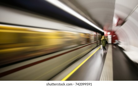 subway train passing by station ,people waiting