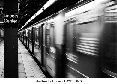 Subway train rushing through Lincoln Center station in New York City black and white