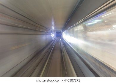 Subway tunnel, metro underground transport with zoom motion blurred light tracks due to the speed of the train