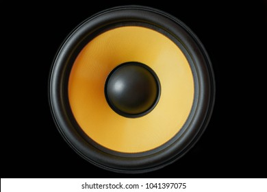 Subwoofer dynamic membrane or sound speaker isolated on black background, yellow Hi-Fi loudspeaker close up macro shot