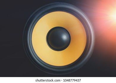 Subwoofer dynamic or sound speaker on black background with light effect, loudspeaker