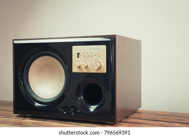 Subwoofer speaker, Digital audio amplifier on wooden table with white background.