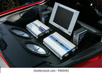 Subwoofers, Amps, and a TV in the back of a Car