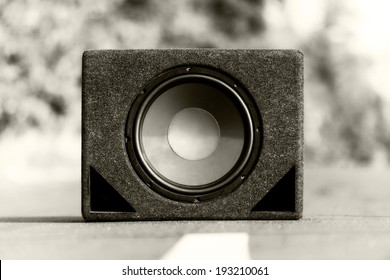 Subwoofers on the road outdoors closeup photo
