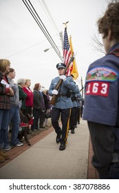 SUCCASUNNA, NJ-DEC 12, 2015: A crowd lines the sidewalk as the Morris County Honor Guard conduct the presentation of colors during the ceremonial wreath laying service for 2015 Wreaths Across America.