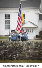 SUCCASUNNA, NJ-DEC 12, 2015: The Morris County Honor Guard march as they retire the colors after the ceremonial wreath laying service for the 2015 Wreaths Across America event coordinated by NSDAR.