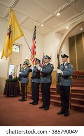 SUCCASUNNA, NJ-DEC 12, 2015: Presentation of Colors by the Morris County Police Color Guard at the memorial service inside the First Presbyterian church for the 2015 Wreaths Across America event.