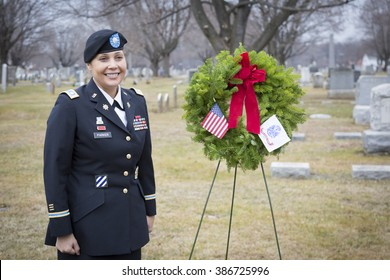 SUCCASUNNA, NJ-DEC 12, 2015: U.S. Army Lt. Col. Ingrid Parker, Garrison Commander at Picatinny Arsenal stands for photographs after the wreath laying memorial service for 2015 Wreaths Across America.