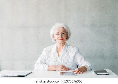 Succesful business woman. Confident female leader. Modern professional approach. Portrait of senior lady sitting at desk.
