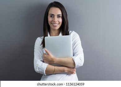 Succesful business woman holding a laptop