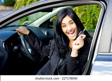 Succesful woman with brand new car