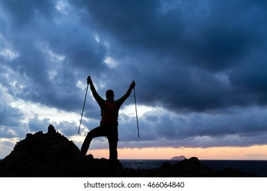 Success achievement trekking or hiking accomplishment. Business concept with man celebrating with arms up raised outstretched hiking, climbing, running outdoors. Motivation and inspiration in nature.