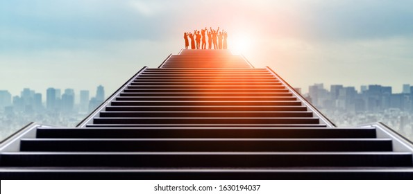 Success of business concept. Group of businessperson on the top of stairs.