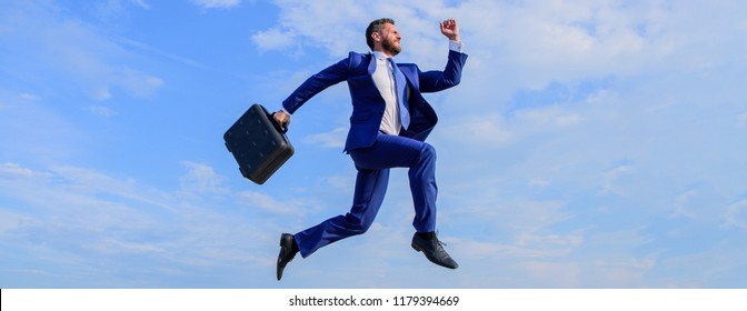 Success in business demands supernatural efforts. Businessman with briefcase jump high in motion forward. Businessman formal suit make effort to succeed blue sky background. Supernatural power.