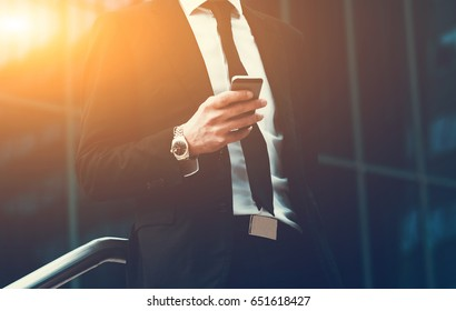 Success business man using cell phone. Concept businessman lifestyle. Toned Image.