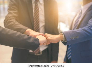 Success Business Partners Giving Fist Bump after Complete a Deal. Successful Teamwork with Hands Gesture Communication.