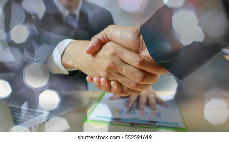 Success business,business concept,Double exposure of handshake and city,Business handshake and business people,Together,businessman and businesswoman shaking hands,selective focus,vintage color