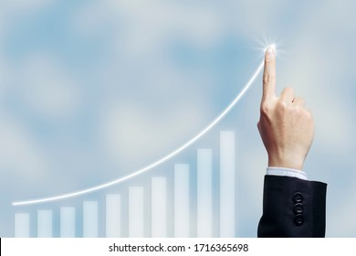 Success businessman with business growing graph growing virtual hologram of statistics, graph with arrow up on white cloud  background. Stock market. Business growth, planing and strategy concept.