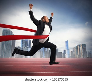 Success of a businessman in a finishing line