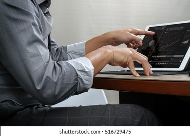 success businessman hand working with,digital tablet docking smart keyboard on wood desk