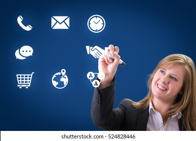 Success businesswoman drawing business icon and chart