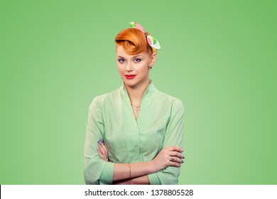 Success. Closeup portrait beautiful businesswoman looking at camera arms crossed, hands folded isolated on green background wall.  Pinup girl retro vintage 50s style smiling Positive face expression