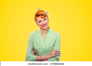 Success. Closeup portrait beautiful radiant businesswoman looking at camera arms crossed, folded isolated yellow background wall.  Pinup girl retro vintage 50s style smiling Positive face expression