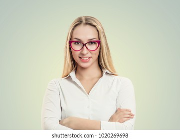 Success. Closeup portrait head shot sexy beautiful happy young woman with glasses arms crossed smiling isolated on yellow green background wall Positive human emotion face expression feeling lifestyle