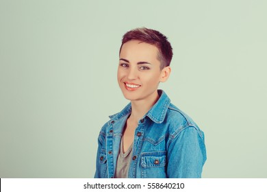 Success. Closeup portrait head shot confident beautiful happy young woman arms crossed smiling isolated green background wall. Positive human emotion face expression feeling life perception attitude