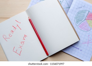 Success concept about education or examination.There are pencils, color, many charts on graph paper,pages of notebook with Ready Exam word on wooden background.