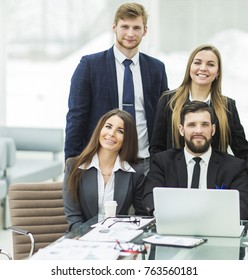 success concept in business - a professional business team in the workplace in the office