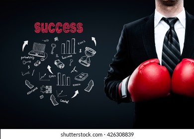 Success concept with businessman in boxing gloves and business sketch