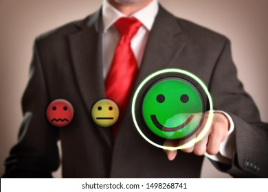 Success concept with businessman pointing out smiley emoticon. Horizontal composition. Front view.