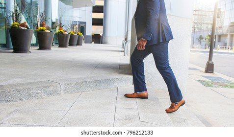 Success concept. Leader Businessman stepping up on career stairs