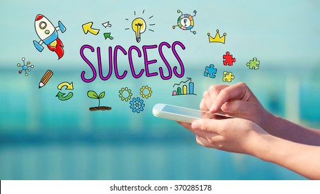 Success concept with person holding a smartphone