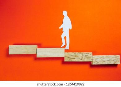 success concept - white man figure on a ladder