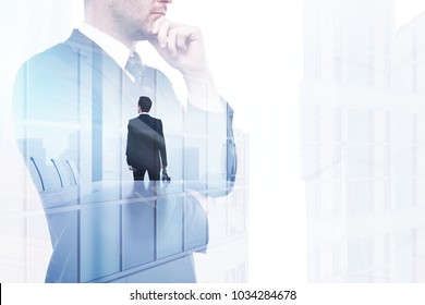 Success and conference concept. Businessman on abstract office city background with copy space. Double exposure
