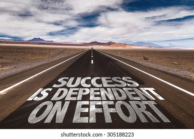 Success is Dependent on Effort written on desert road
