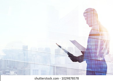 Success and employment concept. Businessman standing on abstract office city background with sunlight. Double exposure