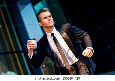 success goal achieve ideas concept caucasian businessman wear suit running fast schedule check on office entrance stair step color tone image