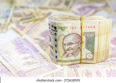 Success and got profit from business with 500 banknotes of indian rupee currency,money,Focus on eye of Gandhi