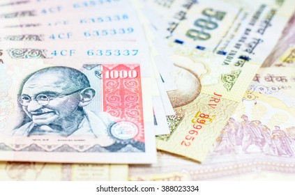 Success and got profit from business with 500 and 1000 banknotes of indian rupee currency,money,Focus on eye of Gandhi