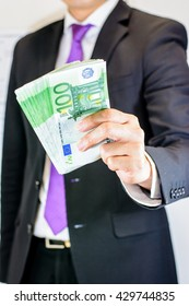 Success and got profit from business with businessman holding Euro currency,money in a hand,Focus on number 100 of banknote