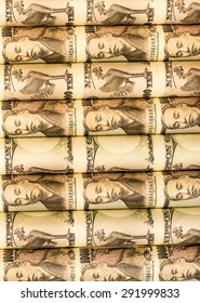 Success and got profit from business with roll of Japanese currency banknotes background