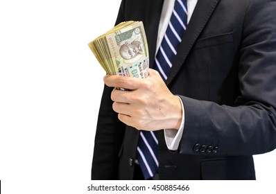 Success and got profit from business with young business man holding Indian rupee cash,money in a hand isolated on white background,Focus on eye of Gandhi on banknotes
