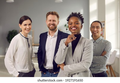 Success, leadership, business collaboration of mixed race specialists concept. Smiling cheerful confident young people office worker of various nationalities standing and looking at camera together