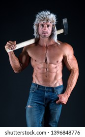 success. man with sexy bare torso in jeans. strong bodybuilder with sexy bare torso. man in hat with fit torso hold heavy sledge hammer. male model with six pack and ab. bodybuilding. achieve success.