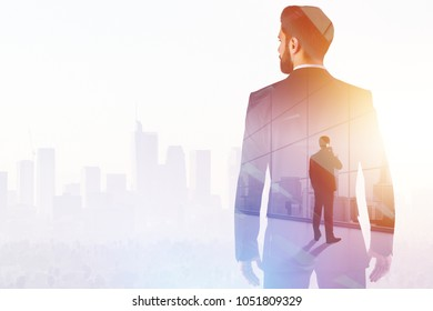 Success and network concept. Businessman on abstract white office and city background with sunlight. Double exposure