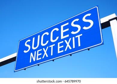 Success - next exit - street sign